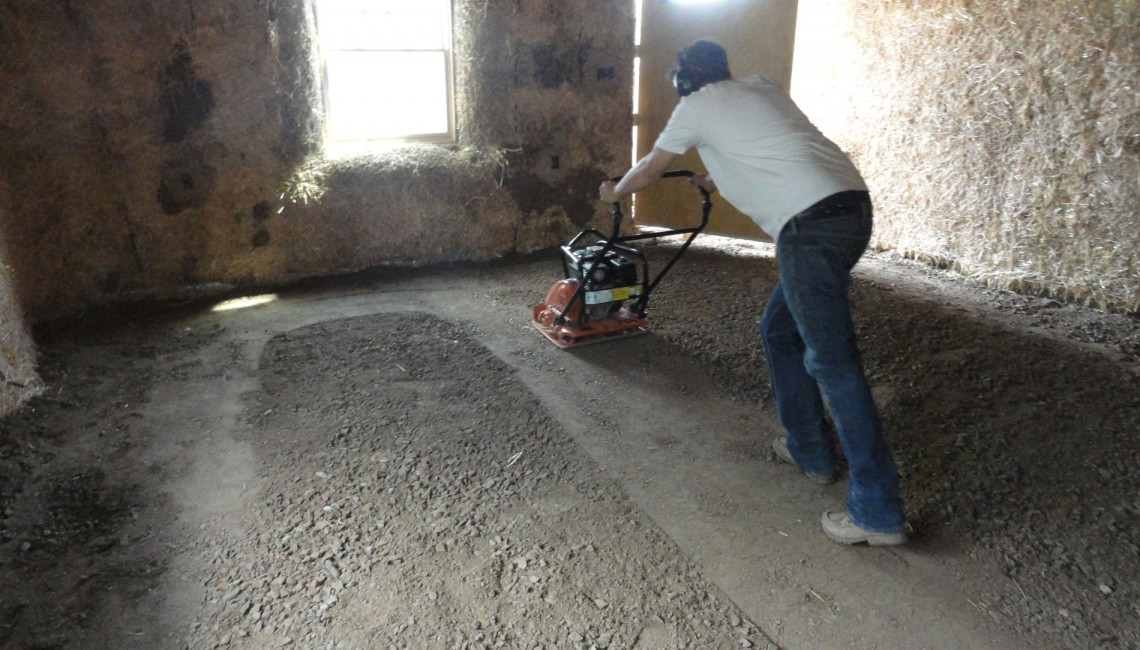 compacting-the-first-layer-of-adobe-floor-2