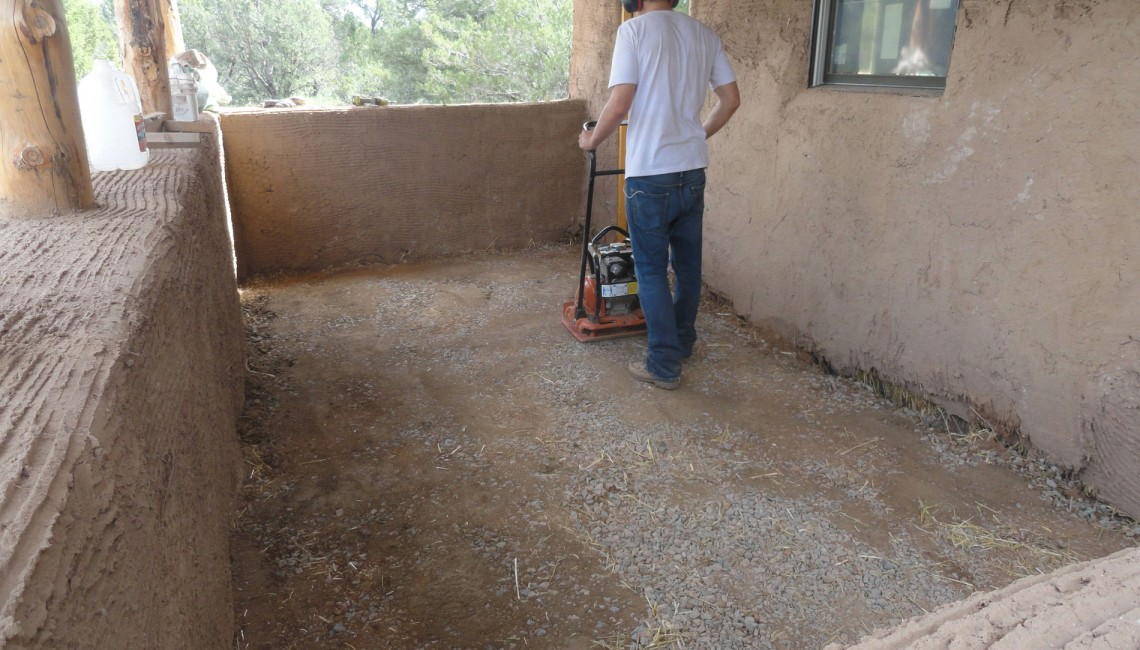compacting-the-first-layer-of-adobe-floor-8