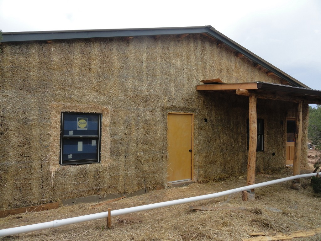 Adobe plaster or conventional stucco straw bale for Adobe home construction