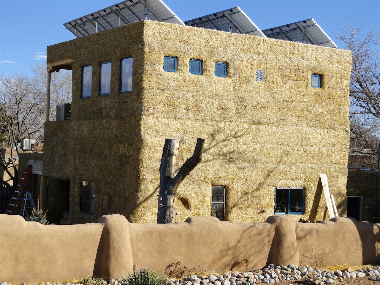 Adobe plaster or conventional stucco straw bale for Adobe house construction cost